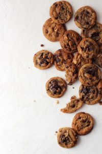 Top down view of chocolate chunk cookies on white background.